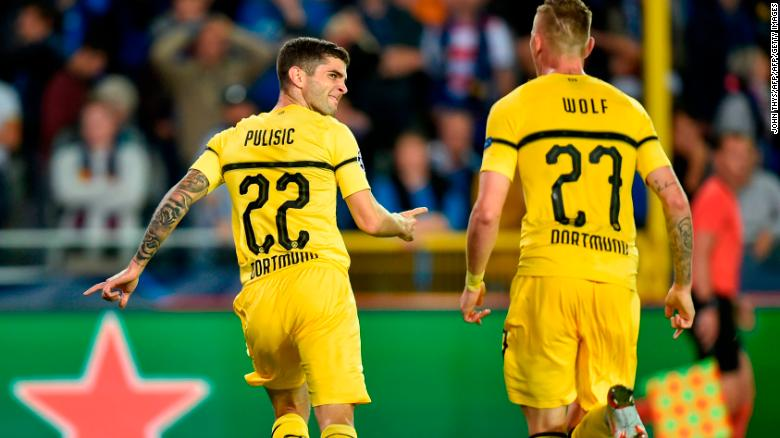 Pulisic celebrates scoring against Club Brugge in the Champions League.
