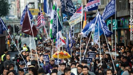 A group of Hong Kong independence supporters display flags during the annual New Year's Day pro-democracy rally in Hong Kong on January 1, 2019.