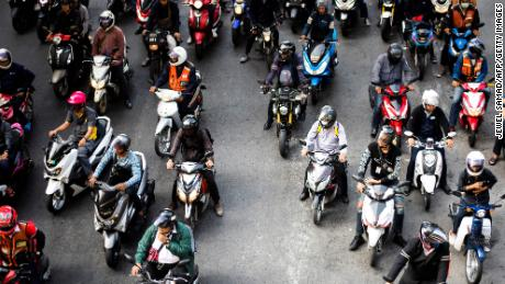 Motorists wait at a traffic light in Bangkok on November 29, 2018.