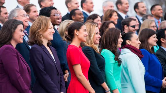 UNITED STATES - NOVEMBER 14: Members-elect including Alexandria Ocasio-Cortez, D-N.Y., in red, pose for the freshman class photo on the East Front of the Capitol on November 14, 2018. (Photo By Tom Williams/CQ Roll Call)