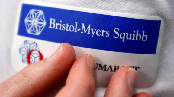 Logo of global biopharmaceutical company Bristol-Myers Squibb is pictured on the blouse of an employee in Le Passage, near Agen, France March 29, 2018. REUTERS/Regis Duvignau
