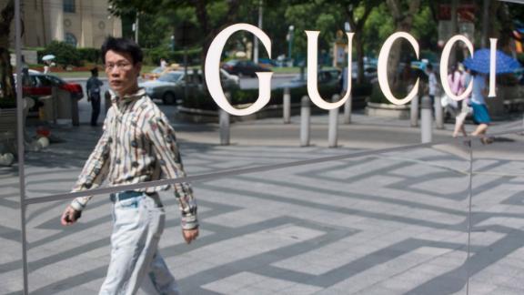 A man walks past a Gucci store in Shanghai.