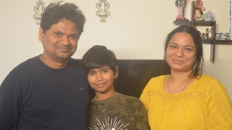 Fifth-grader Advaik Nandikotkur with his proud father and mother after saving the man from drowning.