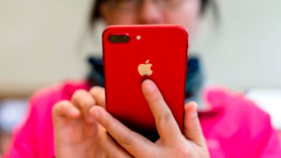 A customer trying a red iPhone 7 in Nanjing, China. Apple on Wednesday said that it expected a weaker Chinese economy to hurt its holiday sales, prompting its stock to plunge.