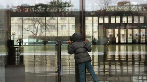 A child looks inside the National Museum of African American History, which was closed because of the shutdown.