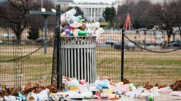 Garbage overflows from a trash can on the National Mall, across from the White House, on Tuesday, January 1. The National Park Service, which is responsible for trash removal, was not operating because of the government shutdown.