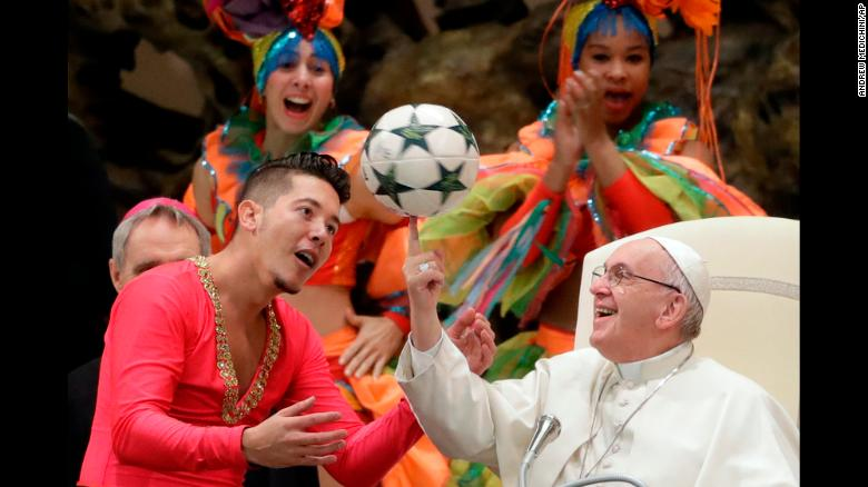 While at the Vatican, Pope Francis twirls a soccer ball that was given to him by a member of the Circus of Cuba on Wednesday, January 2.