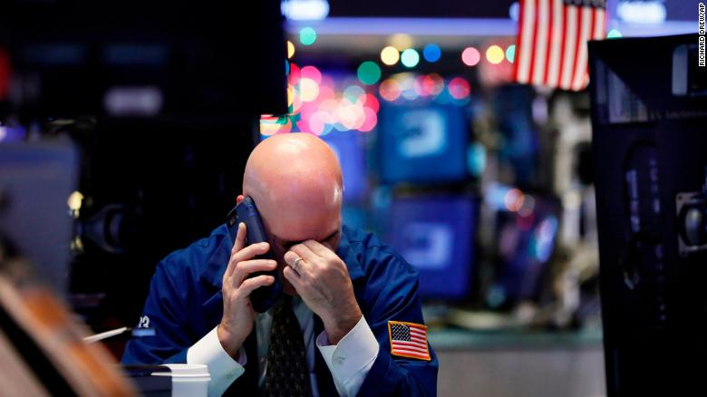 """A trader talks on his phone on the floor of the New York Stock Exchange on Wednesday, January 2. Stock markets started the new year with an early plunge <a href=""""https://www.cnn.com/2019/01/02/investing/stock-market-today-dow/index.html"""" target=""""_blank"""">but recovered by the end of the day.</a>"""