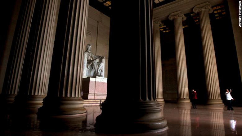 """Visitors take their pictures at the Lincoln Memorial in Washington on Tuesday, January 1. Many of the monuments on the National Mall remained open despite <a href=""""https://www.cnn.com/2018/12/22/politics/gallery/government-shutdown-december-2018/index.html"""" target=""""_blank"""">a partial government shutdown</a> that went into effect on December 22."""