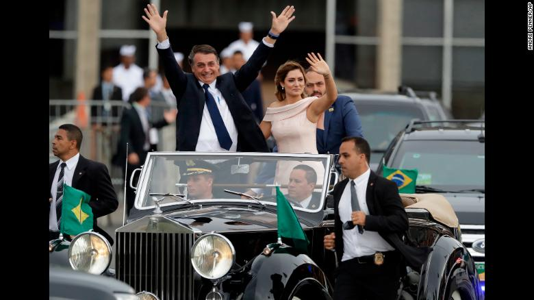 """Brazil's new President, Jair Bolsonaro, is joined by his wife, Michelle, after his swearing-in ceremony in Brasilia on Tuesday, January 1. The former army captain and far-right congressman, <a href=""""https://www.cnn.com/2018/12/31/americas/brazil-bolsonaro-inauguration-intl/index.html"""" target=""""_blank"""">who campaigned as a political outsider and anti-corruption candidate,</a> won a comfortable victory in October over his nearest rival in one of the most polarizing and violent political contests in Brazil's history."""