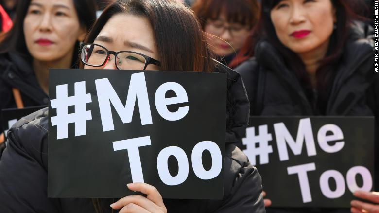 South Korean demonstrators hold banners during a rally to mark International Women's Day as part of the country's #MeToo movement in Seoul on March 8, 2018.