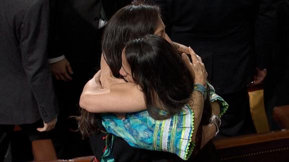 Rep. Deb Haaland (D-NM) and Sharice Davids (D-KS) embrace on the House floor 01/03.