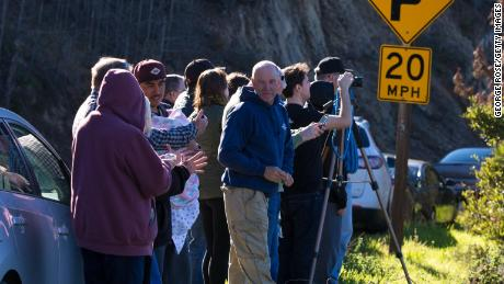 People gather to watch SpaceX successfully launch a Falcon 9 rocket from Vandenberg Air Force Base on January 14, 2017, in Lompoc, California.