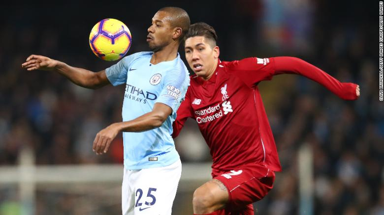 Liverpool's Roberto Firmino challenges Manchester City's Fernandinho during City's 2-1 win in January.