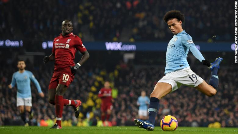 Sane scores the decisive goal for Man City against Liverpool.