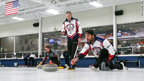 Allen, right, practices with his curling team for a competition as coach and former Olympian John Benton watches in Blaine, Minnesota.