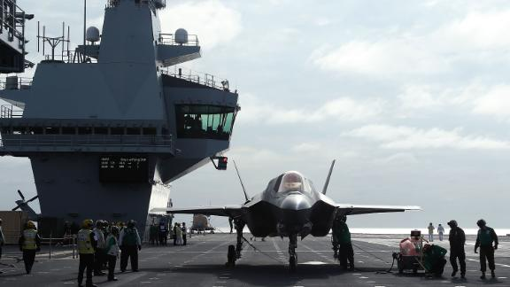 A new F-35B fighter jet is prepped for take off from the deck of the United Kingdom's aircraft carrier HMS Queen Elizabeth in 2018. The jet's electronics enable close coordination between allied air forces.
