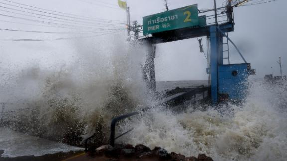 Waves crash into a pier in the southern Thai province of Surat Thani on Friday.