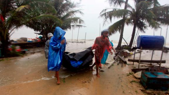 Locals clear the shoreline in preparation for the approaching Tropical Storm Pabuk, Friday, Jan. 4, 2019, in Pak Phanang, in the southern province of Nakhon Si Thammarat, southern Thailand. Rain, winds and surging seawater are striking southern Thailand as a strengthening tropical storm nears coastal villages and popular tourist resorts. (AP Photo/Sumeth Panpetch)