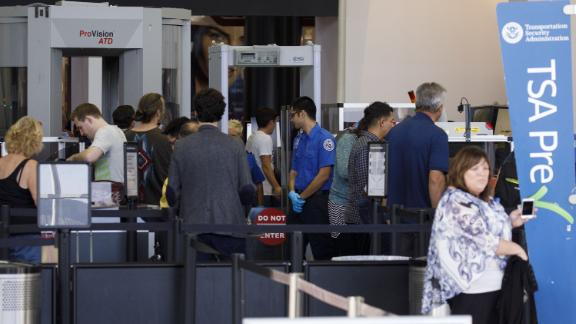 Travelers carry baggage for screening at a Transportation Security Administration (TSA) checkpoint at Los Angeles International Airport (LAX) in Los Angeles, California, U.S., on Thursday, Oct. 25, 2018. A new LAX policy will allow travelers to possess a small amount of marijuana inside the airport, and on planes, if the traveler is flying to a state where weed is legal. Photographer: Patrick T. Fallon/Bloomberg via Getty Images