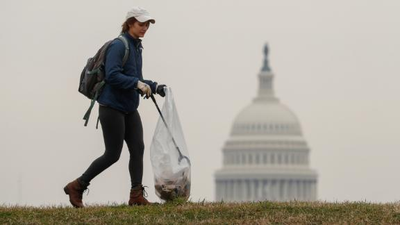 Volunteers, many of whom are furloughed workers, clean up trash on the National Mall in response to the partial government shutdown in Washington, U.S., January 4, 2019.