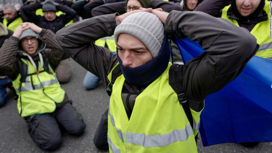Yellow vest protestors kneel in Lyon on January 5. About 50,000 people demonstrated throughout France on Saturday, according to Interior Minister Christophe Castaner.