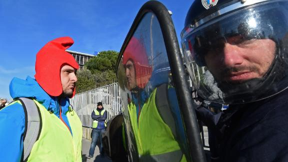 A yellow vest demonstrator faces riot police officers in Marseille, France, on Saturday, January 5, 2019.