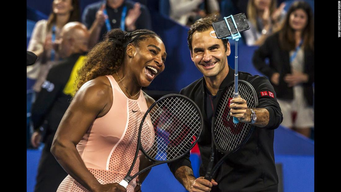 Tennis legends Serena Williams and Roger Federer take a selfie after playing in a mixed-doubles match on Tuesday, January 1. The Hopman Cup match was the first time the two greats had ever competed against each other.