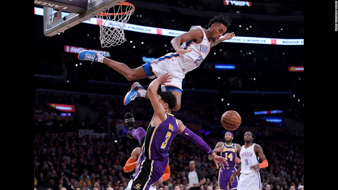 Oklahoma City's Terrance Ferguson goes flying over the Lakers' Josh Hart during an NBA game in Los Angeles on Wednesday, January 2. Ferguson was called for a foul on the play.