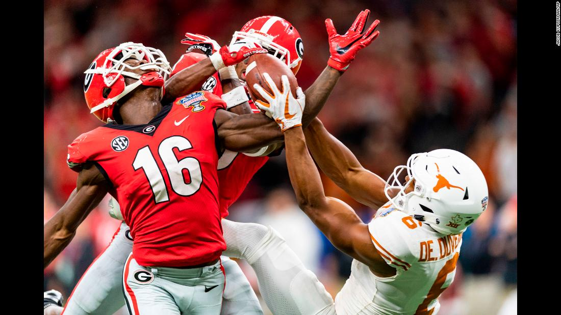 Texas wide receiver Devin Duvernay, right, competes for a ball with two Georgia defensive backs during the Sugar Bowl on Tuesday, January 1. Texas won the game 28-21.