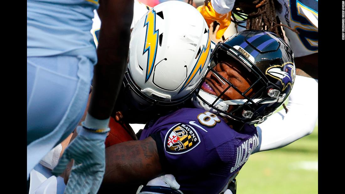 Baltimore's Lamar Jackson is crunched by Los Angeles Chargers defensive end Joey Bosa during an NFL playoff game on Sunday, January 6. The Chargers frustrated the rookie quarterback for much of the afternoon as they defeated the Ravens 23-17.