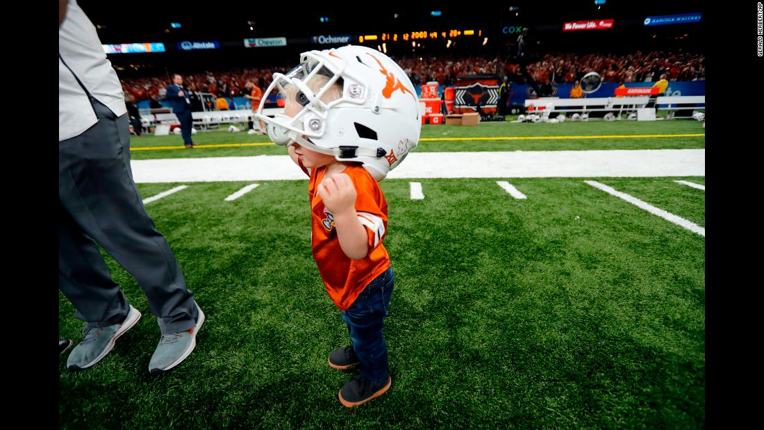 Beau Rutherford, the 1-year-old son of Texas equipment manager Matt Rutherford, dons a Texas helmet after the Sugar Bowl on Tuesday, January 1.