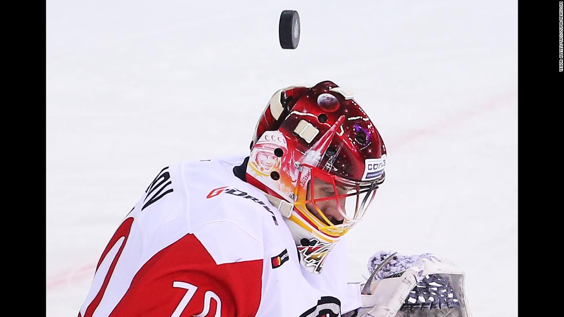 The puck flies over the helmet of Avangard Omsk goalie Ivan Nalimov during a KHL game in Kazan, Russia, on Thursday, January 3.