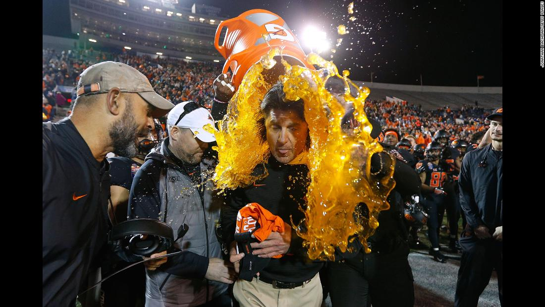 Oklahoma State head coach Mike Gundy is doused with Gatorade after his football team won the Liberty Bowl on Monday, December 31.