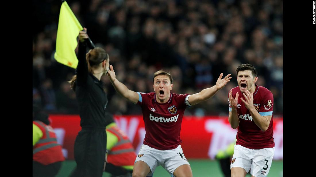 West Ham's Mark Noble, center, and Aaron Cresswell protest a call during a Premier League soccer match in London on Wednesday, January 2.