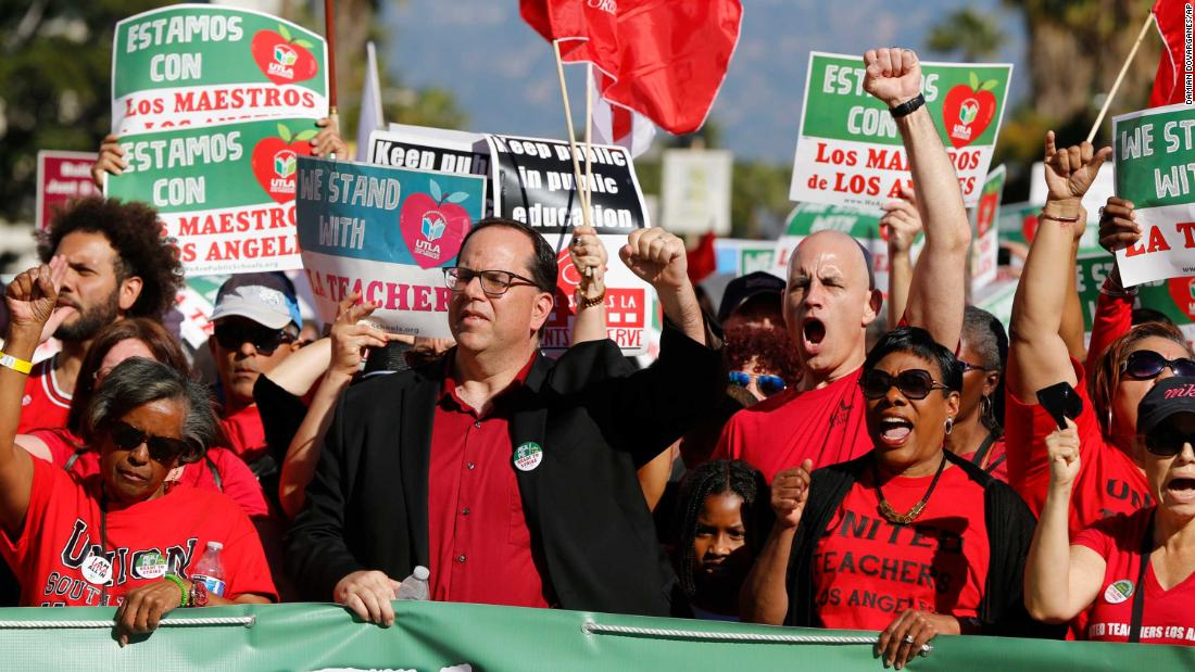 UTLA President Alex Caputo-Pearl, center, joins teachers at a rally December 15, 2018 in Los Angeles.