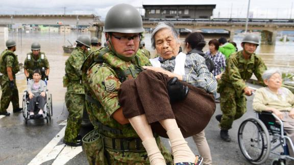Patients of Mabi Memorial Hospital are rescued by Self-Defense Force members on July 8, 2018 in Kurashiki, Okayama, Japan.