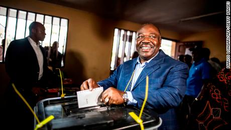 Ali Bongo casts his vote at a polling station during the presidential election on August 27, 2016 in Libreville.