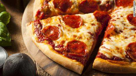 A pilot had pizza delivered to his planeload of passengers who were stuck during a snowstorm