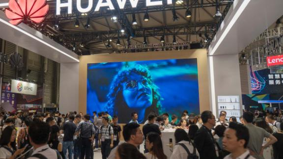 SHANGHAI, CHINA - JUNE 13:  People visit the Huawei stand during the Consumer Electronics Show (CES) Asia at Shanghai New International Expo Centre on June 13, 2018 in Shanghai, China. 2018 CES Asia will rum from June 13 to 15 in Shanghai.  (Photo by VCG/VCG via Getty Images)