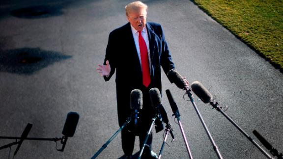 "US President Donald Trump speaks to the press as he departs the White House in Washington, DC, on January 6, 2019, for meetings at Camp David. - President Donald Trump stood firm Sunday on his demand for billions of dollars to fund a border wall with Mexico, which has forced a shutdown of the US government now entering its third week.""We have to build the wall,"" Trump told reporters as he left the  White House for the Camp David presidential retreat, while  conceding that the barrier could be ""steel instead of concrete."" (Photo by Jim WATSON / AFP)        (Photo credit should read JIM WATSON/AFP/Getty Images)"