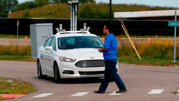A Ford Fusion development vehicle that is equipped with Level 4 Autonomous controls maneuvers at the McityTest Facility on September 12, 2017 in Ann Arbor, Michigan.  The facility is the first purpose-built proving ground for testing connected and automated vehicles and technologies in simulated urban and suburban driving environments. / AFP PHOTO / JEFF KOWALSKY        (Photo credit should read JEFF KOWALSKY/AFP/Getty Images)