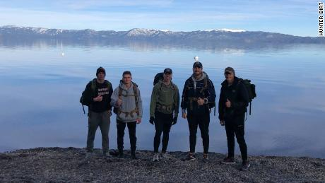 The five men took turns, each walking an average 20 miles a day carrying a 50-pound rucksack.