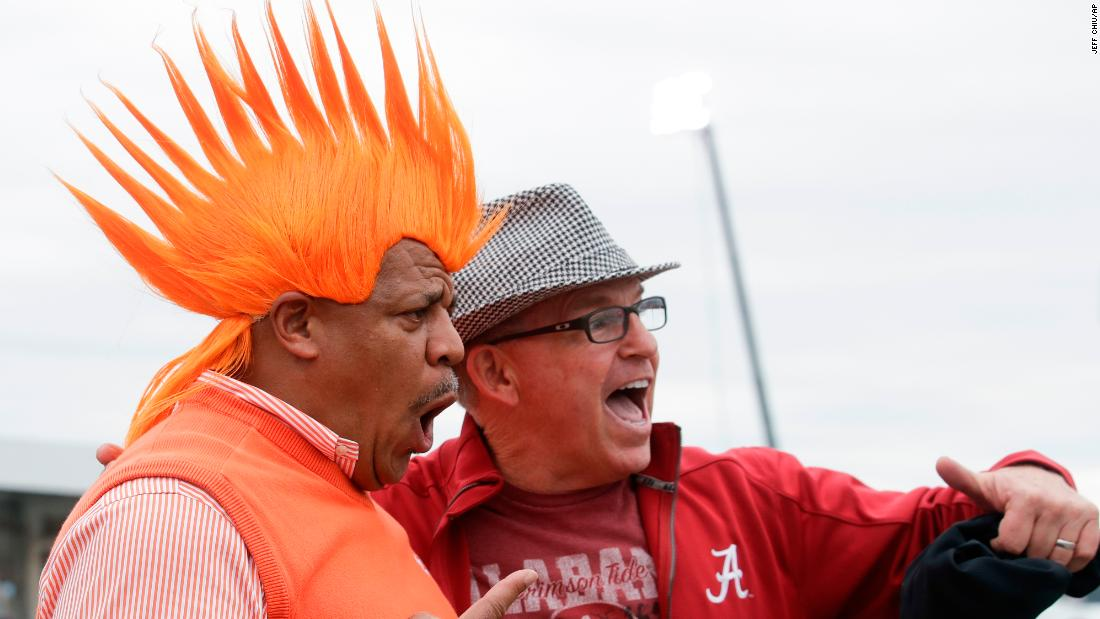 Fans Jerry Edwards and Bill Chase have some fun together before the game.