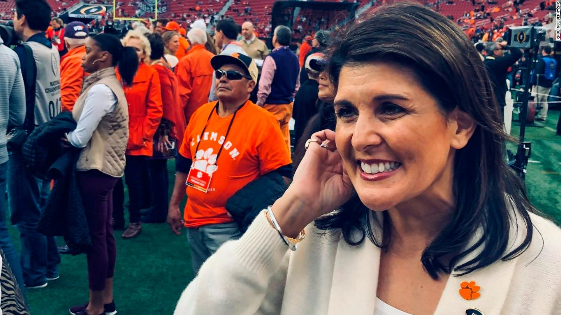 Nikki Haley, the former US ambassador to the United Nations, watches the teams warm up. Haley went to Clemson.