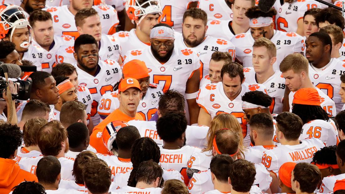 Swinney addresses the Tigers before the game.
