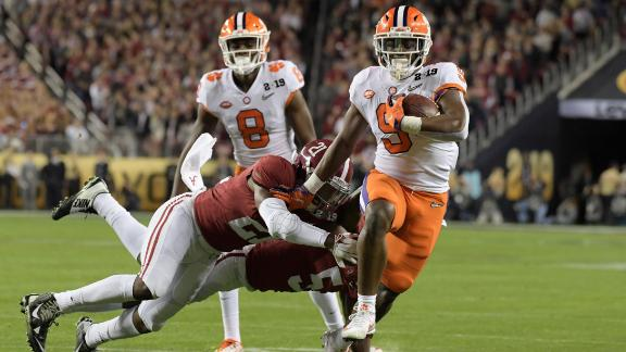 Jan 7, 2019; Santa Clara, CA, USA; Clemson Tigers running back Travis Etienne (9) runs against Alabama Crimson Tide defensive back Jared Mayden (21) and defensive back Shyheim Carter (5) in the first quarter during the 2019 College Football Playoff Championship game at Levi's Stadium. Mandatory Credit: Kirby Lee-USA TODAY Sports