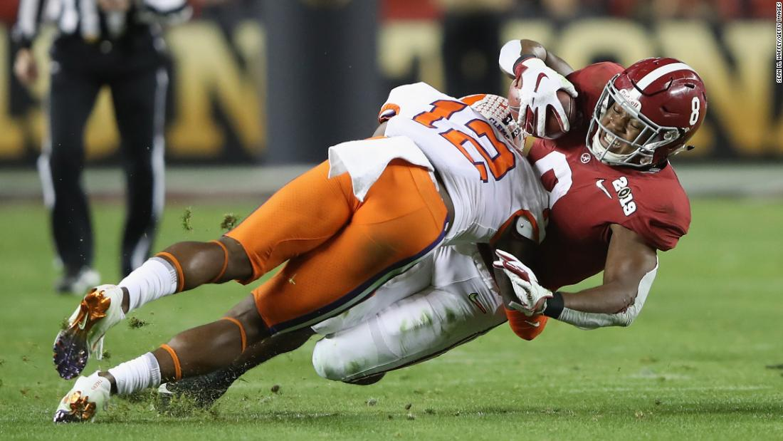 Clemson's K'Von Wallace tackles Alabama running back Josh Jacobs in the first half.