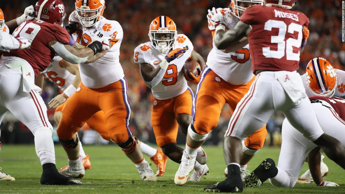 Clemson running back Travis Etienne runs for one of his three first-half touchdowns. His third gave the Tigers a 28-16 lead, and they added a field goal to lead 31-16 at halftime.