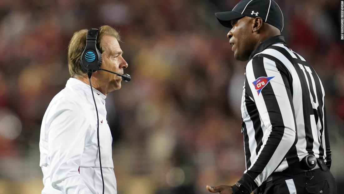 Saban speaks to an official during the third quarter.